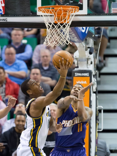 Feb 26, 2014; Salt Lake City, UT, USA; Utah Jazz point guard Alec Burks (10) shoots against Phoenix Suns power forward Markieff Morris (11) during the first half at EnergySolutions Arena. Mandatory Credit: Russ Isabella-USA TODAY Sports