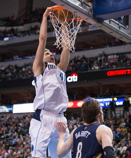 Feb 26, 2014; Dallas, TX, USA; Dallas Mavericks power forward Dirk Nowitzki (41) dunks the ball over New Orleans Pelicans small forward Luke Babbitt (8) during the second half at the American Airlines Center. The Mavericks defeated the Pelicans 108-89. Mandatory Credit: Jerome Miron-USA TODAY Sports