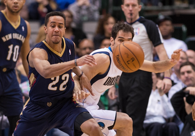 Feb 26, 2014; Dallas, TX, USA; Dallas Mavericks point guard Jose Calderon (8) steals the ball from New Orleans Pelicans point guard Brian Roberts (22) during the second half at the American Airlines Center. The Mavericks defeated the Pelicans 108-89. Mandatory Credit: Jerome Miron-USA TODAY Sports