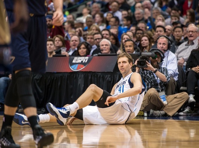 Feb 26, 2014; Dallas, TX, USA; Dallas Mavericks power forward Dirk Nowitzki (41) falls to the court after being fouled during the second against the New Orleans Pelicans half at the American Airlines Center. The Mavericks defeated the Pelicans 108-89. Mandatory Credit: Jerome Miron-USA TODAY Sports