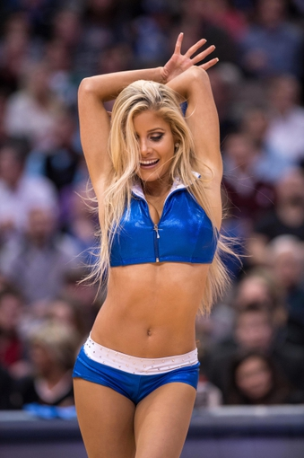 Feb 26, 2014; Dallas, TX, USA; The Dallas Mavericks dancers perform during the second half of the game between the Mavericks and the New Orleans Pelicans at the American Airlines Center. The Mavericks defeated the Pelicans 108-89. Mandatory Credit: Jerome Miron-USA TODAY Sports