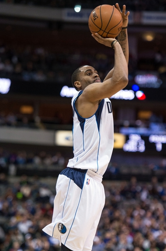 Feb 26, 2014; Dallas, TX, USA; Dallas Mavericks shooting guard Wayne Ellington (21) shoots a three point shot during the second half against the New Orleans Pelicans at the American Airlines Center. Ellington goes 4 of 5 on three point shots. The Mavericks defeated the Pelicans 108-89. Mandatory Credit: Jerome Miron-USA TODAY Sports