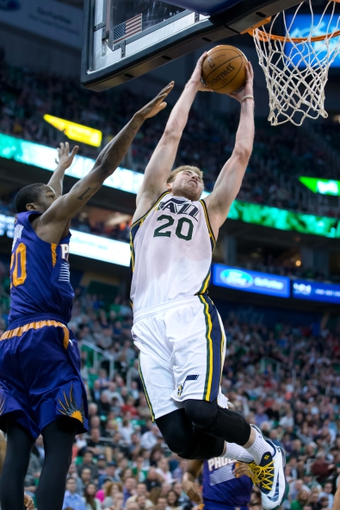 Feb 26, 2014; Salt Lake City, UT, USA; Utah Jazz shooting guard Gordon Hayward (20) dunks the ball in front of Phoenix Suns shooting guard Archie Goodwin (20) during the second half at EnergySolutions Arena. The Jazz won 109-86. Mandatory Credit: Russ Isabella-USA TODAY Sports