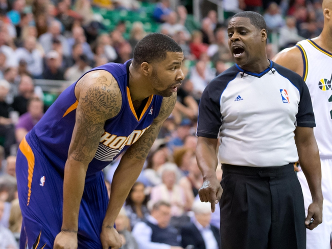 Feb 26, 2014; Salt Lake City, UT, USA; referee Leroy Richardson (20) talks with Phoenix Suns power forward Marcus Morris (15) during the second half at EnergySolutions Arena. The Jazz won 109-86. Mandatory Credit: Russ Isabella-USA TODAY Sports