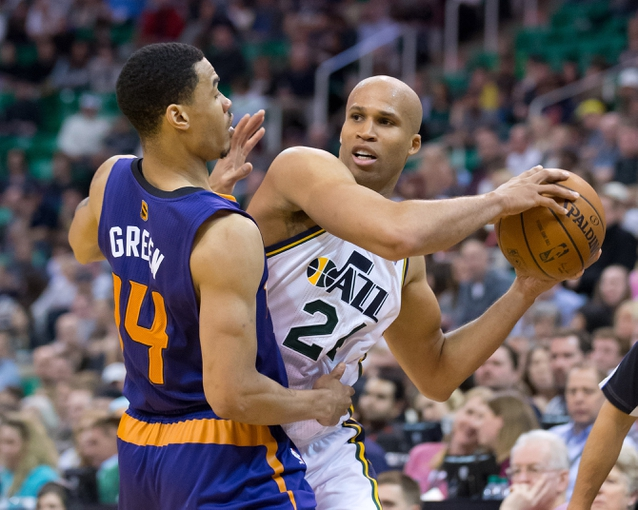 Feb 26, 2014; Salt Lake City, UT, USA; Phoenix Suns shooting guard Gerald Green (14) defends against Utah Jazz small forward Richard Jefferson (24) during the second half at EnergySolutions Arena. The Jazz won 109-86. Mandatory Credit: Russ Isabella-USA TODAY Sports