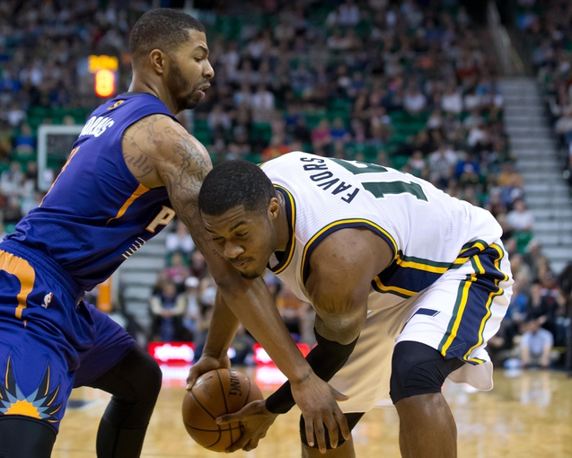 Feb 26, 2014; Salt Lake City, UT, USA; Phoenix Suns power forward Marcus Morris (15) defends against Utah Jazz center Derrick Favors (15) during the second half at EnergySolutions Arena. The Jazz won 109-86. Mandatory Credit: Russ Isabella-USA TODAY Sports