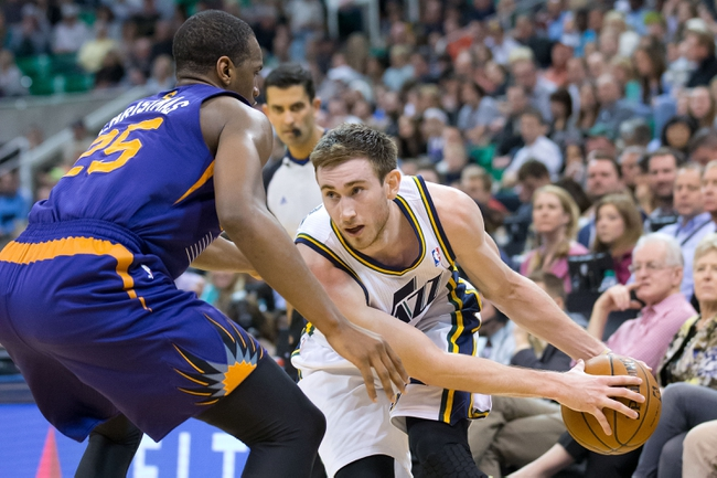 Feb 26, 2014; Salt Lake City, UT, USA; Phoenix Suns shooting guard Dionte Christmas (25) defends against Utah Jazz shooting guard Gordon Hayward (20) during the second half at EnergySolutions Arena. The Jazz won 109-86. Mandatory Credit: Russ Isabella-USA TODAY Sports