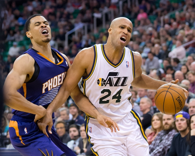 Feb 26, 2014; Salt Lake City, UT, USA; Phoenix Suns shooting guard Gerald Green (14) fouls Utah Jazz small forward Richard Jefferson (24) during the second half at EnergySolutions Arena. The Jazz won 109-86. Mandatory Credit: Russ Isabella-USA TODAY Sports