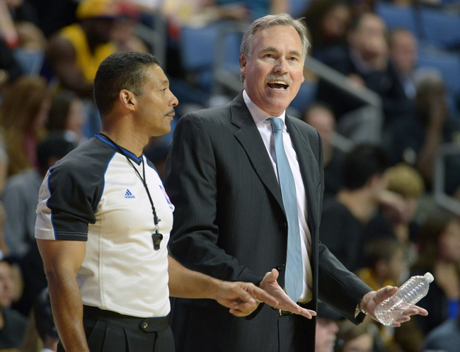 Oct 8, 2013; Ontario, CA, USA;  Los Angeles Lakers coach Mike D'Antoni (right) and referee Bill Kennedy (58) react during the game against the Denver Nuggets at Citizens Business Bank Arena. The Lakers defeated the Nuggets 90-88. Mandatory Credit: Kirby Lee-USA TODAY Sports
