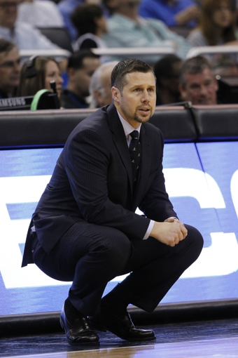 Feb 12, 2014; Orlando, FL, USA; Memphis Grizzlies head coach David Joerger against the Orlando Magic during the second half at Amway Center. Memphis Grizzlies defeated the Orlando Magic 86-81. Mandatory Credit: Kim Klement-USA TODAY Sports