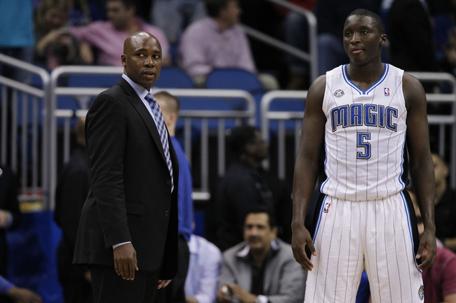 Feb 12, 2014; Orlando, FL, USA; Orlando Magic head coach Jacque Vaughn talks with shooting guard Victor Oladipo (5) against the Memphis Grizzlies during the second half at Amway Center. Memphis Grizzlies defeated the Orlando Magic 86-81. Mandatory Credit: Kim Klement-USA TODAY Sports