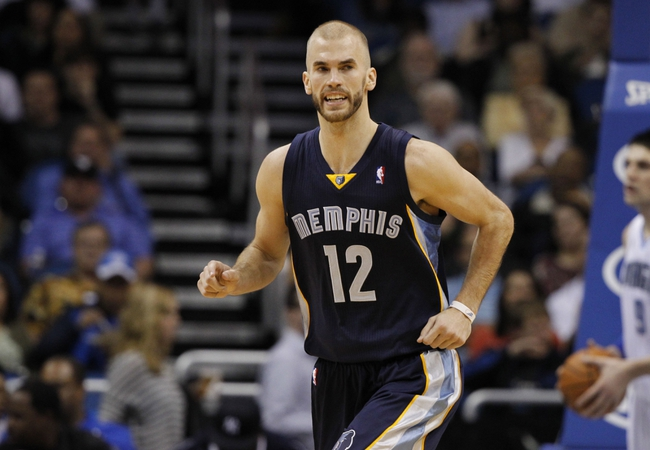 Feb 12, 2014; Orlando, FL, USA; Memphis Grizzlies shooting guard Nick Calathes (12) reacts against the Orlando Magic during the second half at Amway Center. Memphis Grizzlies defeated the Orlando Magic 86-81. Mandatory Credit: Kim Klement-USA TODAY Sports