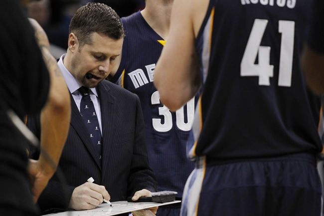 Feb 12, 2014; Orlando, FL, USA; Memphis Grizzlies head coach David Joerger in a huddle with his team against the Orlando Magic during the second half at Amway Center. Memphis Grizzlies defeated the Orlando Magic 86-81. Mandatory Credit: Kim Klement-USA TODAY Sports