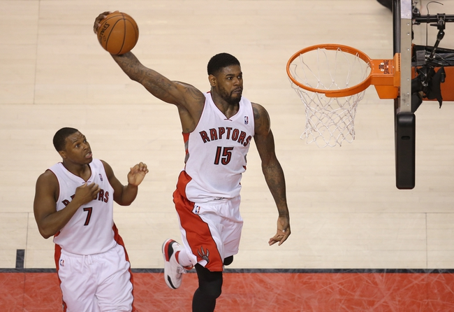 Feb 27, 2014; Toronto, Ontario, CAN; Toronto Raptors forward Amir Johnson (15) dunks against the Washington Wizards at Air Canada Centre. Mandatory Credit: Tom Szczerbowski-USA TODAY Sports