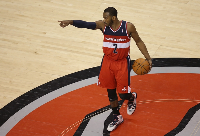 Feb 27, 2014; Toronto, Ontario, CAN; Washington Wizards guard John Wall (10) brings the ball up the court against the Toronto Raptors at Air Canada Centre. Mandatory Credit: Tom Szczerbowski-USA TODAY Sports