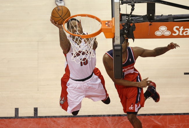 Feb 27, 2014; Toronto, Ontario, CAN; Toronto Raptors guard DeMar DeRozan (10) ties the game on the penultimate play of the second overtime period against the Washington Wizards at Air Canada Centre. Mandatory Credit: Tom Szczerbowski-USA TODAY Sports