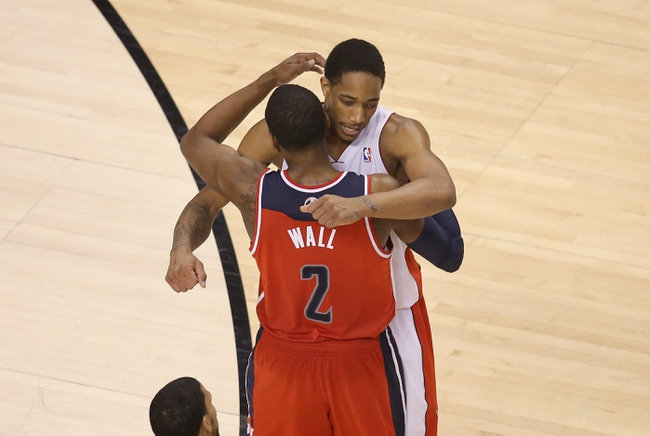 Feb 27, 2014; Toronto, Ontario, CAN; Washington Wizards guard John Wall (10) is congratulated by Toronto Raptors guard DeMar DeRozan (10) after the end of the game at Air Canada Centre. The Wizards beat the Raptors 134-129 in triple overtime. Mandatory Credit: Tom Szczerbowski-USA TODAY Sports