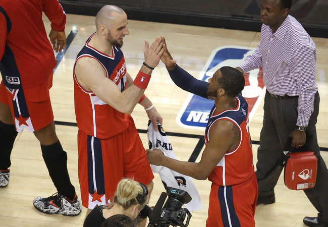 Feb 27, 2014; Toronto, Ontario, CAN; Washington Wizards center Marcin Gortat (4) celebrates their victory with guard John Wall (10) against the Toronto Raptors at Air Canada Centre. The Wizards beat the Raptors 134-129 in triple overtime. Mandatory Credit: Tom Szczerbowski-USA TODAY Sports