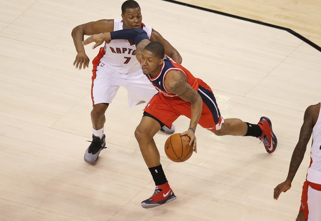 Feb 27, 2014; Toronto, Ontario, CAN; Washington Wizards guard Bradley Beal (3) dribbles against the Toronto Raptors at Air Canada Centre. The Wizards beat the Raptors 134-129 in triple overtime. Mandatory Credit: Tom Szczerbowski-USA TODAY Sports