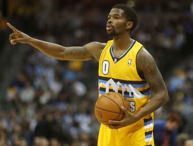 Feb 27, 2014; Denver, CO, USA; Denver Nuggets guard Aaron Brooks (0) during the first half against the Brooklyn Nets at Pepsi Center. Mandatory Credit: Chris Humphreys-USA TODAY Sports