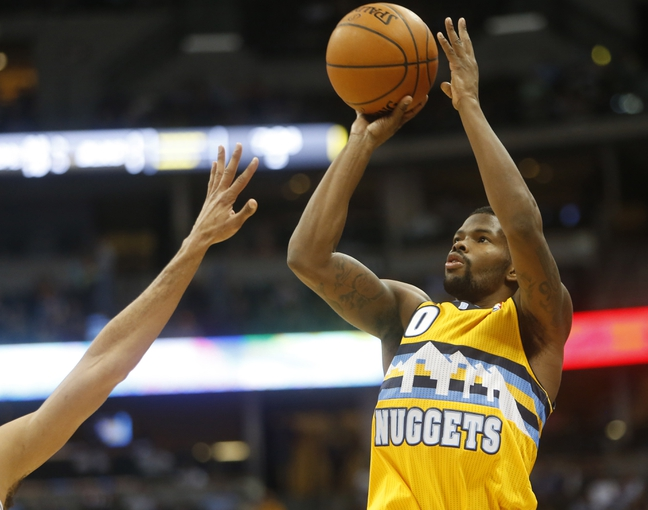 Feb 27, 2014; Denver, CO, USA; Denver Nuggets guard Aaron Brooks (0) shoots the ball during the first half against the Brooklyn Nets at Pepsi Center. Mandatory Credit: Chris Humphreys-USA TODAY Sports