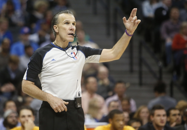 Feb 27, 2014; Denver, CO, USA; Referee Ken Mauer signals during the first half between the Denver Nuggets and the Brooklyn Nets at Pepsi Center. Mandatory Credit: Chris Humphreys-USA TODAY Sports