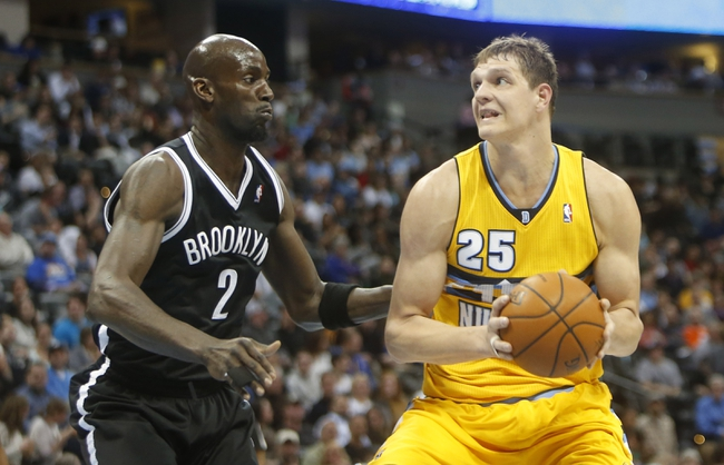 Feb 27, 2014; Denver, CO, USA; Denver Nuggets center Timofey Mozgov (25) against Brooklyn Nets forward Kevin Garnett (2) during the first half at Pepsi Center. Mandatory Credit: Chris Humphreys-USA TODAY Sports