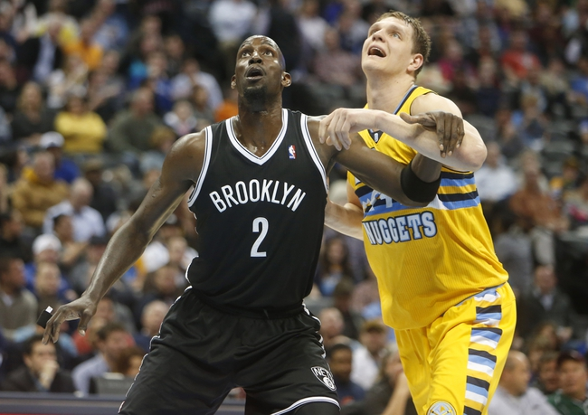 Feb 27, 2014; Denver, CO, USA; Denver Nuggets center Timofey Mozgov (25) and Brooklyn Nets forward Kevin Garnett (2) battle for position during the first half at Pepsi Center. Mandatory Credit: Chris Humphreys-USA TODAY Sports
