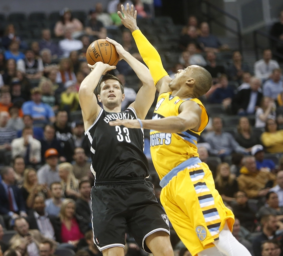 Feb 27, 2014; Denver, CO, USA; Brooklyn Nets forward Mirza Teletovic (33) shoots the ball during the second half against the Denver Nuggets at Pepsi Center.  The Nets won 112-89.  Mandatory Credit: Chris Humphreys-USA TODAY Sports
