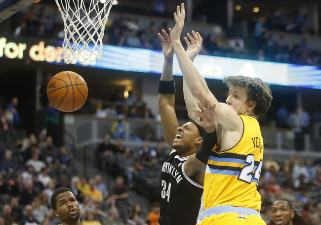 Feb 27, 2014; Denver, CO, USA; Brooklyn Nets forward Paul Pierce (34) is fouled by Denver Nuggets forward Jan Vesely (24) during the second half at Pepsi Center.  The Nets won 112-89.  Mandatory Credit: Chris Humphreys-USA TODAY Sports