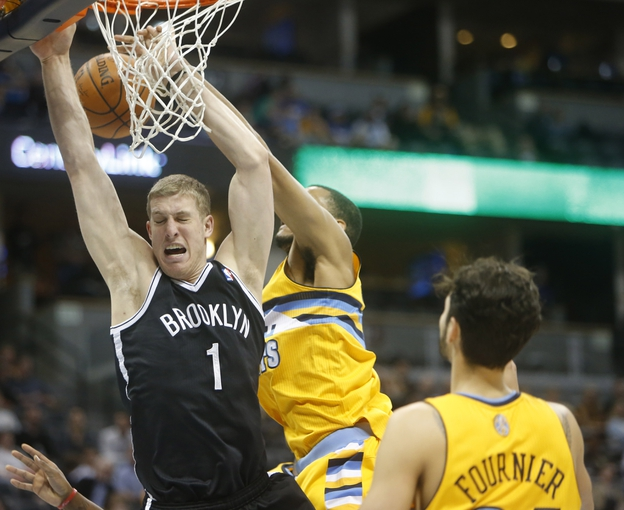 Feb 27, 2014; Denver, CO, USA; Brooklyn Nets center Mason Plumlee (1) is fouled during the second half against the Denver Nuggets at Pepsi Center.  The Nets won 112-89.  Mandatory Credit: Chris Humphreys-USA TODAY Sports