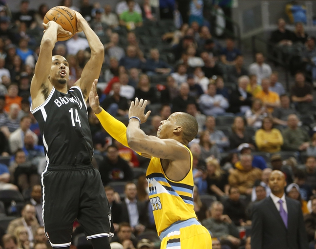 Feb 27, 2014; Denver, CO, USA; Brooklyn Nets guard Shaun Livingston (14) shoots the ball during the second half against the Denver Nuggets at Pepsi Center.  The Nets won 112-89.  Mandatory Credit: Chris Humphreys-USA TODAY Sports