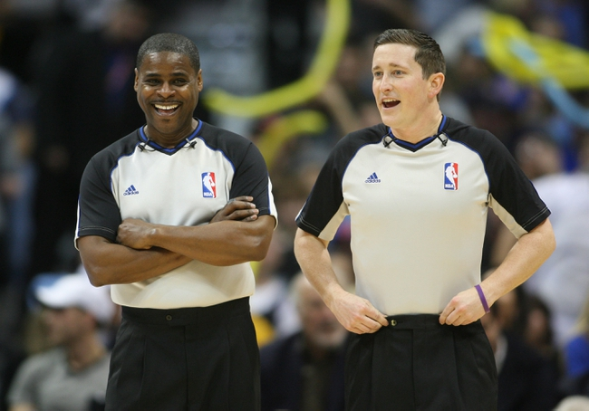 Feb 27, 2014; Denver, CO, USA; NBA referees Nick Buchert (left) and Leroy Richardson (right) during the first half between the Denver Nuggets and the Brooklyn Nets at Pepsi Center.  The Nets won 112-89.  Mandatory Credit: Chris Humphreys-USA TODAY Sports
