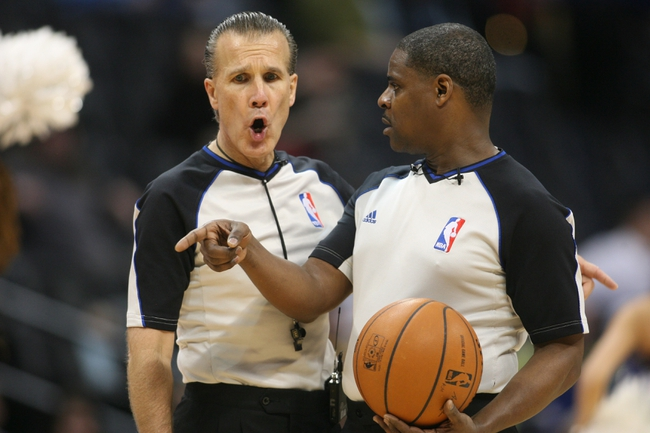Feb 27, 2014; Denver, CO, USA; NBA referees Nick Buchert (right) and Ken Mauer (left) discus a play during the second half between the Denver Nuggets and the Brooklyn Nets at Pepsi Center.  The Nets won 112-89.  Mandatory Credit: Chris Humphreys-USA TODAY Sports