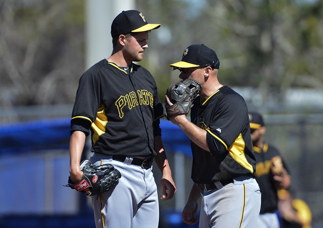Feb 28, 2014; Dunedin, FL, USA; Pittsburgh Pirates relief pitcher Andy Oliver (52) and  shortstop Clint Barmes (12) talk at the mound during the sixth inning against the Toronto Blue Jays at Florida Auto Exchange Park. Toronto Blue Jays defeated Pittsburgh Pirates  4-2. Mandatory Credit: Tommy Gilligan-USA TODAY Sports