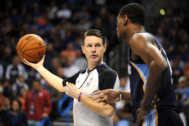 Feb 28, 2014; Oklahoma City, OK, USA; NBA official Pat Fraher discusses a call with Memphis Grizzlies shooting guard Tony Allen (9) during the second quarter at Chesapeake Energy Arena. Mandatory Credit: Mark D. Smith-USA TODAY Sports
