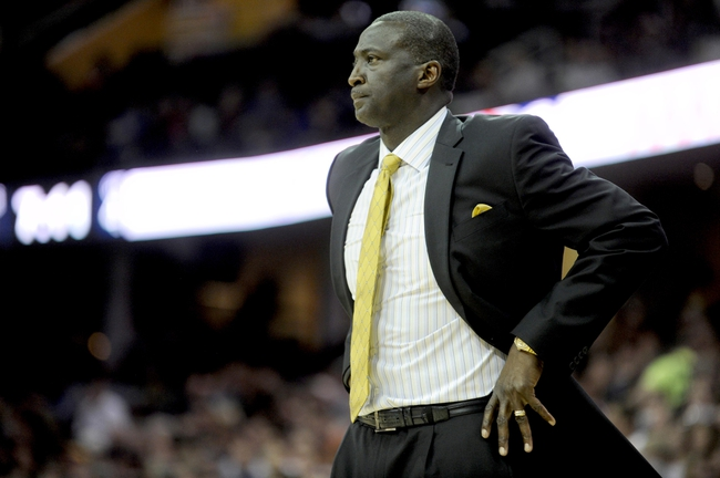Feb 28, 2014; Cleveland, OH, USA; Utah Jazz head coach Tyrone Corbin watches from the sideline during the fourth quarter at Quicken Loans Arena. Mandatory Credit: Ken Blaze-USA TODAY Sports