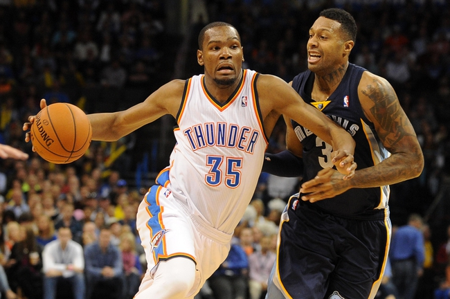 Feb 28, 2014; Oklahoma City, OK, USA; Oklahoma City Thunder small forward Kevin Durant (35) drives the ball against Memphis Grizzlies power forward James Johnson (3) during the fourth quarter at Chesapeake Energy Arena. Mandatory Credit: Mark D. Smith-USA TODAY Sports
