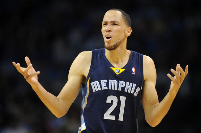 Feb 28, 2014; Oklahoma City, OK, USA; Memphis Grizzlies small forward Tayshaun Prince (21) reacts to a call in action against the Oklahoma City Thunder during the fourth quarter at Chesapeake Energy Arena. Mandatory Credit: Mark D. Smith-USA TODAY Sports