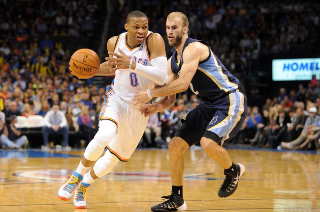 Feb 28, 2014; Oklahoma City, OK, USA; Oklahoma City Thunder point guard Russell Westbrook (0) drives the ball against Memphis Grizzlies shooting guard Nick Calathes (12) during the fourth quarter at Chesapeake Energy Arena. Mandatory Credit: Mark D. Smith-USA TODAY Sports