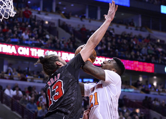Mar 2, 2014; Chicago, IL, USA; New York Knicks shooting guard Iman Shumpert (21) shoots the ball against Chicago Bulls center Joakim Noah (13) during the first half at the United Center. Mandatory Credit: Mike DiNovo-USA TODAY Sports