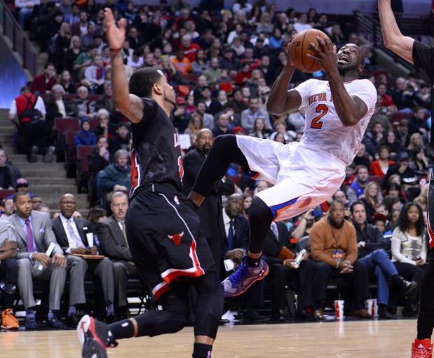 Mar 2, 2014; Chicago, IL, USA; New York Knicks point guard Raymond Felton (2) shoots the ball against Chicago Bulls point guard D.J. Augustin (14) during the first half at the United Center. Mandatory Credit: Mike DiNovo-USA TODAY Sports
