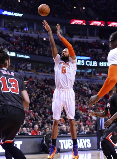 Mar 2, 2014; Chicago, IL, USA; New York Knicks center Tyson Chandler (6) shoots the ball against the Chicago Bulls during the first half at the United Center. Mandatory Credit: Mike DiNovo-USA TODAY Sports
