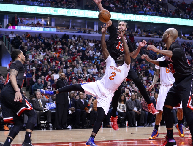 Mar 2, 2014; Chicago, IL, USA; New York Knicks point guard Raymond Felton (2) shoots the ball against Chicago Bulls center Joakim Noah (13) during the first half at the United Center. Mandatory Credit: Mike DiNovo-USA TODAY Sports
