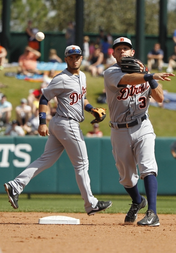 Mar 2, 2014; Lake Buena Vista, FL, USA; Detroit Tigers second baseman Ian Kinsler (3) throws the ball to first for a double play during the fourth inning against the Atlanta Braves at Champion Stadium. Mandatory Credit: Kim Klement-USA TODAY Sports