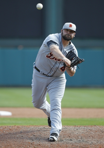 Mar 2, 2014; Lake Buena Vista, FL, USA; Detroit Tigers relief pitcher Joba Chamberlain (44) throws the ball during the sixth inning against the Atlanta Braves at Champion Stadium. Mandatory Credit: Kim Klement-USA TODAY Sports