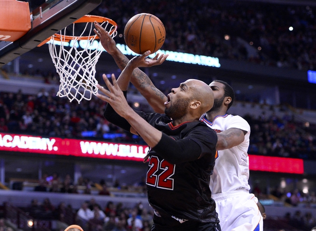 Mar 2, 2014; Chicago, IL, USA; Chicago Bulls power forward Taj Gibson (22) shoots the ball against New York Knicks small forward Earl Clark (0) during the second half at the United Center. Chicago defeats New York 109-90. Mandatory Credit: Mike DiNovo-USA TODAY Sports