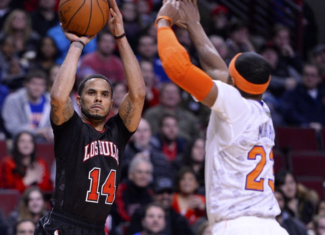 Mar 2, 2014; Chicago, IL, USA; Chicago Bulls point guard D.J. Augustin (14) shoots the ball against New York Knicks shooting guard Toure' Murry (23) during the second half at the United Center. Chicago defeats New York 109-90. Mandatory Credit: Mike DiNovo-USA TODAY Sports