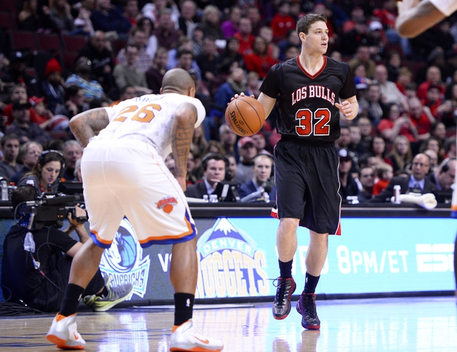 Mar 2, 2014; Chicago, IL, USA; Chicago Bulls point guard Jimmer Fredette (32) dribbles the ball against New York Knicks point guard Shannon Brown (26) during the second half at the United Center. Chicago defeats New York 109-90. Mandatory Credit: Mike DiNovo-USA TODAY Sports