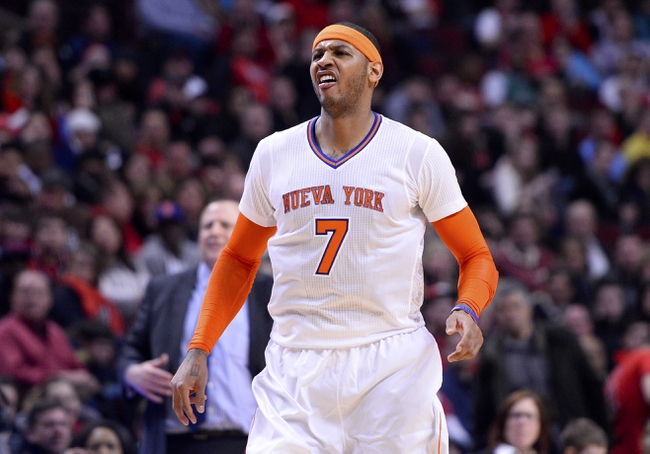 Mar 2, 2014; Chicago, IL, USA; New York Knicks small forward Carmelo Anthony (7) reacts after missing a shot against the Chicago Bulls during the second half at the United Center. Chicago defeats New York 109-90. Mandatory Credit: Mike DiNovo-USA TODAY Sports